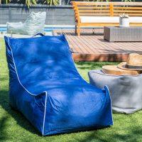 Blue coastal lounge on lawn in the sunshine
