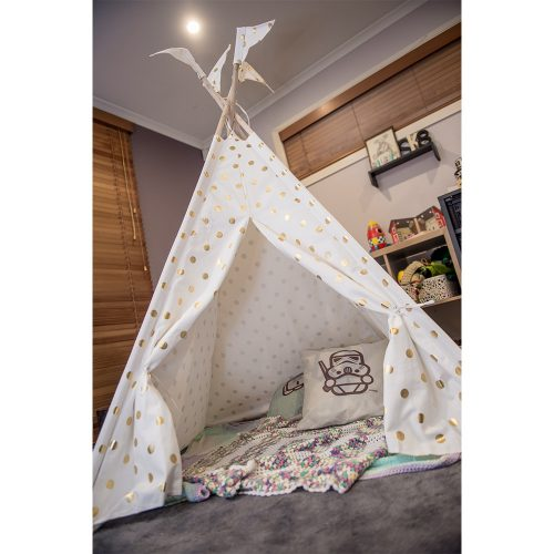 White gold coin teepee setup in kids playroom with blankets and cushions