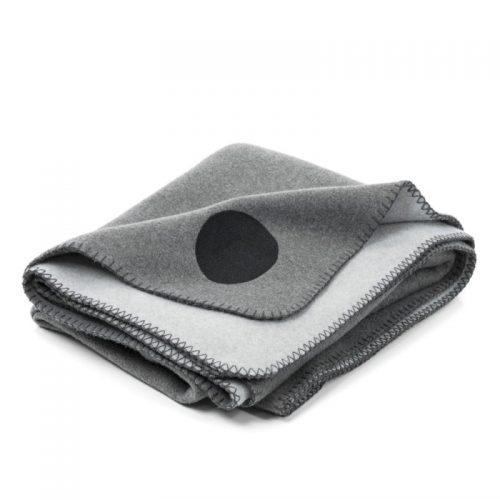 Folded grey designer fleece blanket for indoor and outdoor use