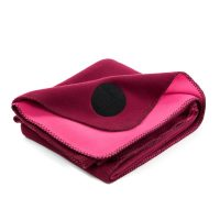 Folded burgundy wine colored designer fleece blanket rug for indoor and outdoor use