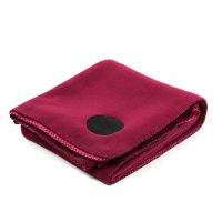 Folded burgundy red wine colored designer fleece blanket rug for indoor and outdoor use
