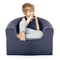 Toddler sits in a crown blue, solid foam, childrens junior size pop arm chair seat