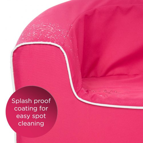 Close up of the splash proof coating on the rasberry pink junior pop kids solid foam armchair, for easy spot cleaning