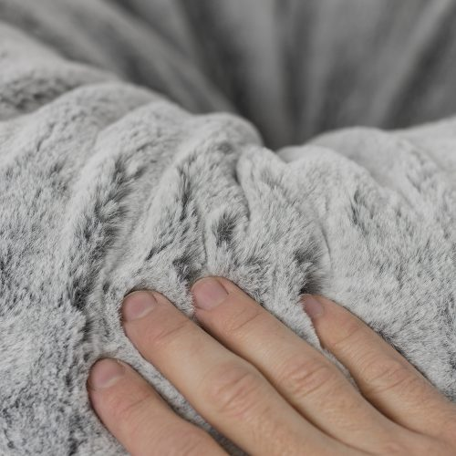 A close up of the grey faux fur bean bag