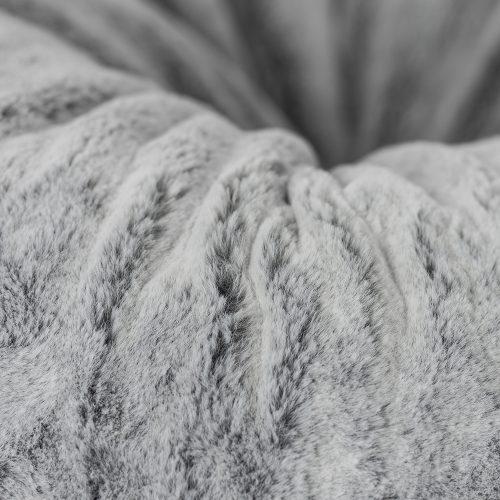 Close up of the bean bag grey faux fur material