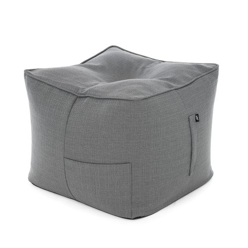A square grey linen bean bag ottoman that can be used as a chair, table or footrest. Carry handle and storage pocket are visible.