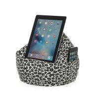 Brown leopard print iCrib bean bag cushioning a table or iPad with a smart phone or mobile phone stashed in the storage pocket