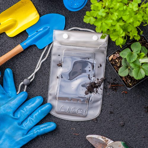A clear plastic sleeve with LiFE! logo protects an iphone or mobile phone from dirt and moisture in the garden. The image is framed by gloves, trowels and plants.