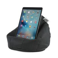 An ipad or table sits on the iCrib bean bag made from a black material with herringbone pattern.