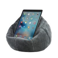 The charcoal faux fur iCrib tablet bean bag with an iPad resting on the bean bag cushion