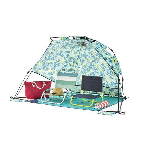 The tropical green adventure sun shelter for the beach, camping and picnics. Shown with two camp chairs inside on a picnic rug.