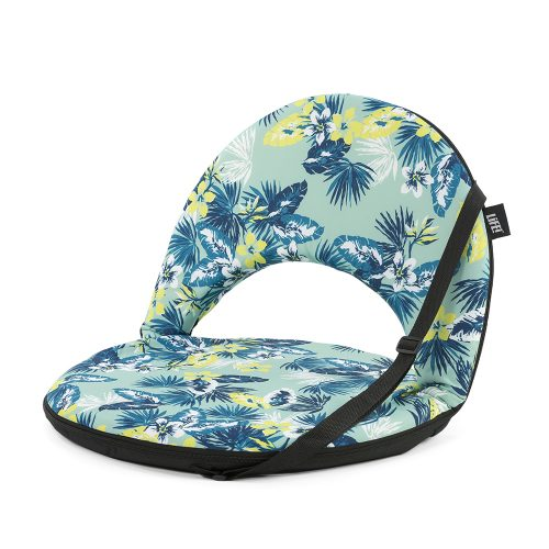 Oblique view of the portable cushion recliner chair in a green and blue tropical floral leave print with carry handle.