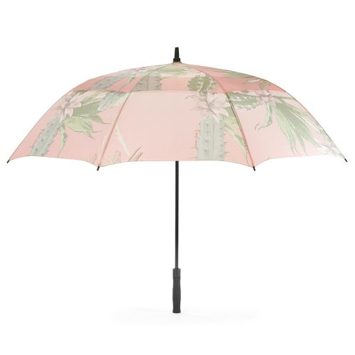 The kakteen print large rain golf umbrella shown open from the side. The print is a soft green and pink with cactus and cactus flowers.