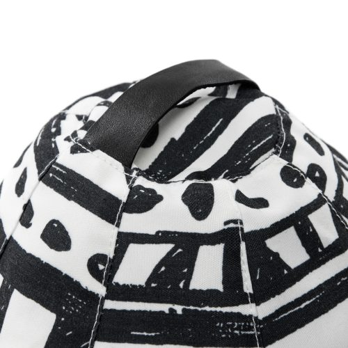 Close up of the carry handle on the black and white geometric print bermuda bean caddy icrib tablet holder iPad cushion