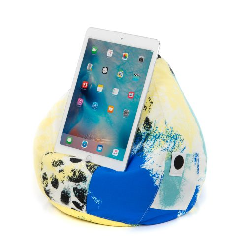 A tablet rests on the Tier print iCrib bean caddy iPad cushion