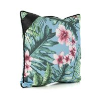 Oblique angle of the belvedere indoor outdoor cushion showing the hand drawn designer tropical print and black trim.