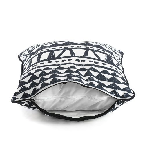 Side view of the bermuda indoor outdoor cushion showing the cover and liner zipper and the black trim.