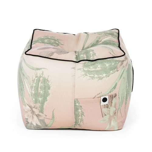 Designer fabric ottoman showing storage pocket. The kakteen print has green cactus on a graduated pink background.