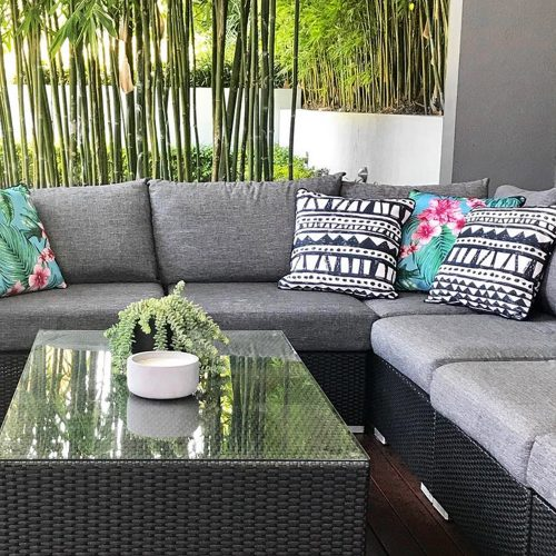 Bermuda and Belvedere print indoor and outdoor cushions on a outdoor setting
