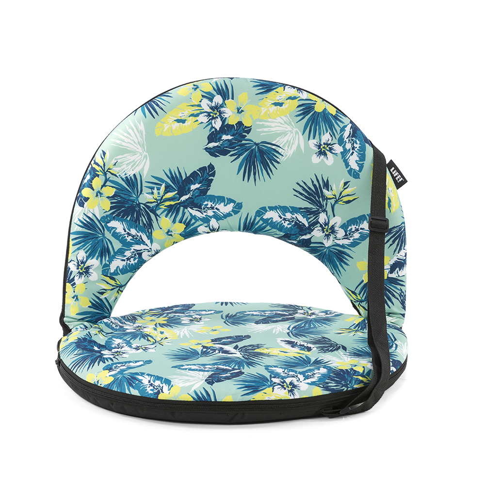 The tropical leaf print cushion recliner chair for beach, picnics or camping. The black trim and carry handle are visible.