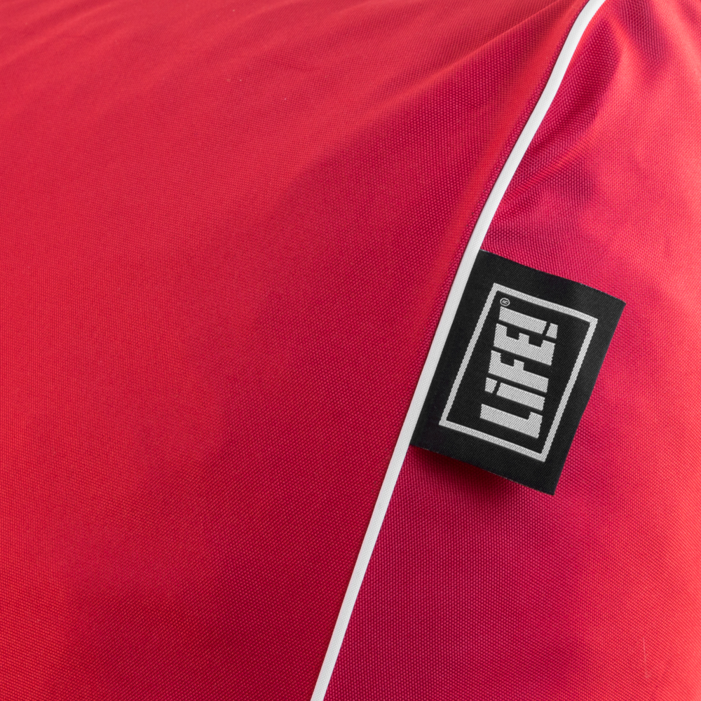 Close up of the red fabric showing the contrast white piping and LiFE! logo tag