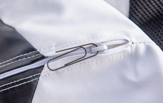 Close up of a paper clip in the safety zipper