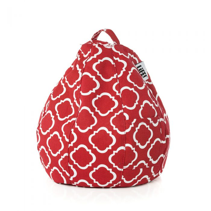 The flame scarlet iCrib in red with a white geometric print. The handle and storage pocket are visible.