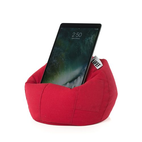 An iPad, tablet or mobile device rests on the bright scarlet red iCrib tablet holder, iPad stand, book rest. A storage pocket can be seen.
