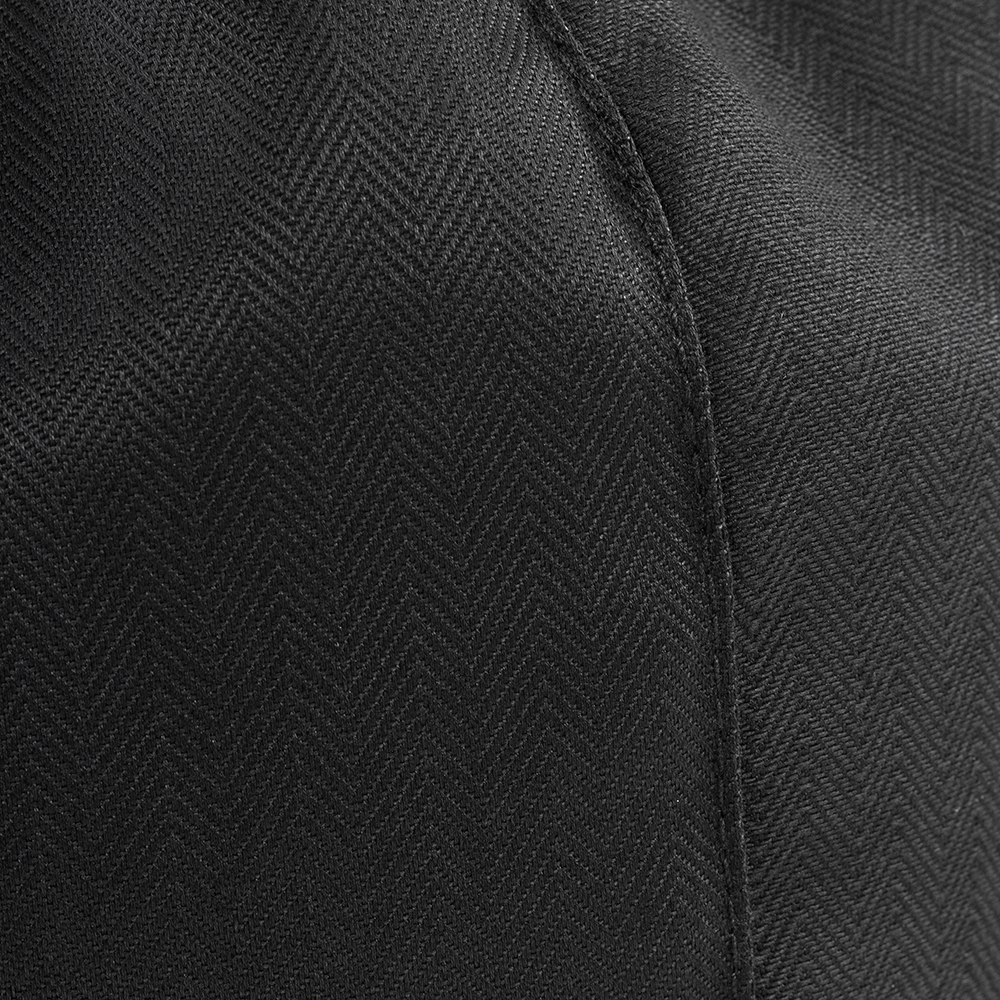 Close up of the black herringbone textured material