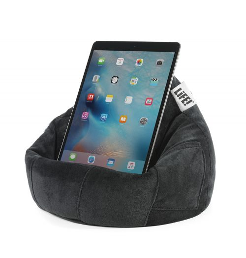 An iPad or tablet sits securely on a black velvet iCrib bean bag book rest ready for hands free use.