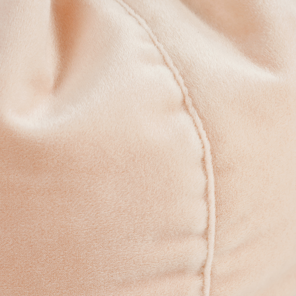 A close up of the soft blush colored peach pink velvet material used in the iCrib