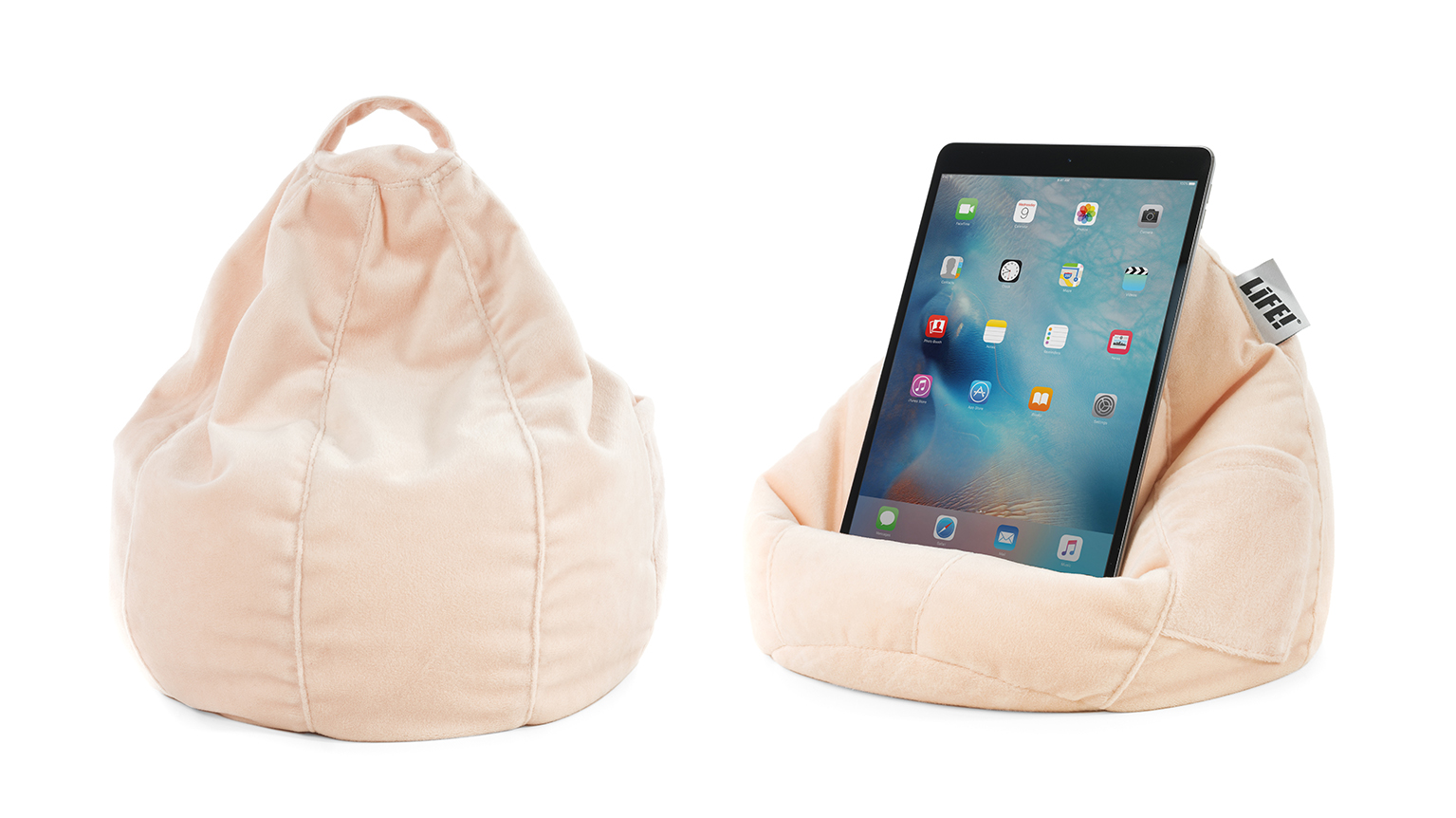 The iCrib is a soft blush peach pink color made from velvet. A tablet, mobile device or iPad rests securely on it. It has a handle and storage pocket.