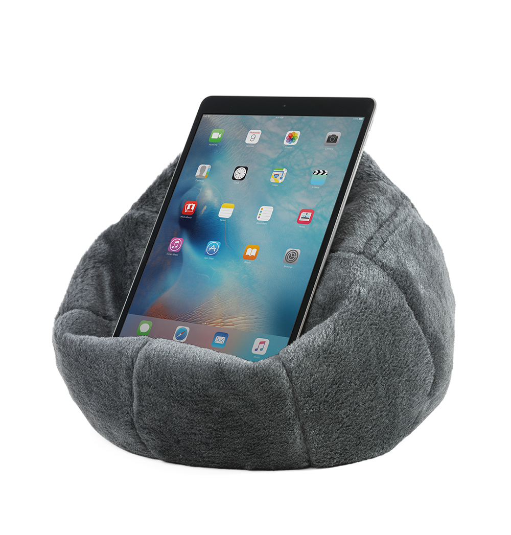 An iPad or tablet rests securely on the charcoal grey faux fur iCrib so you can use it hands free