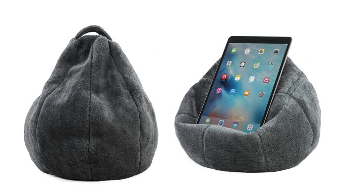 The charcoal faux fur iCrib with a tablet or iPad sitting on it. The handle and storage pocket are visible on the book rest bean bag.
