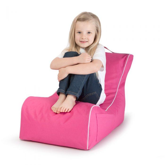 Child sits on kids pink coastal lounge bean bag
