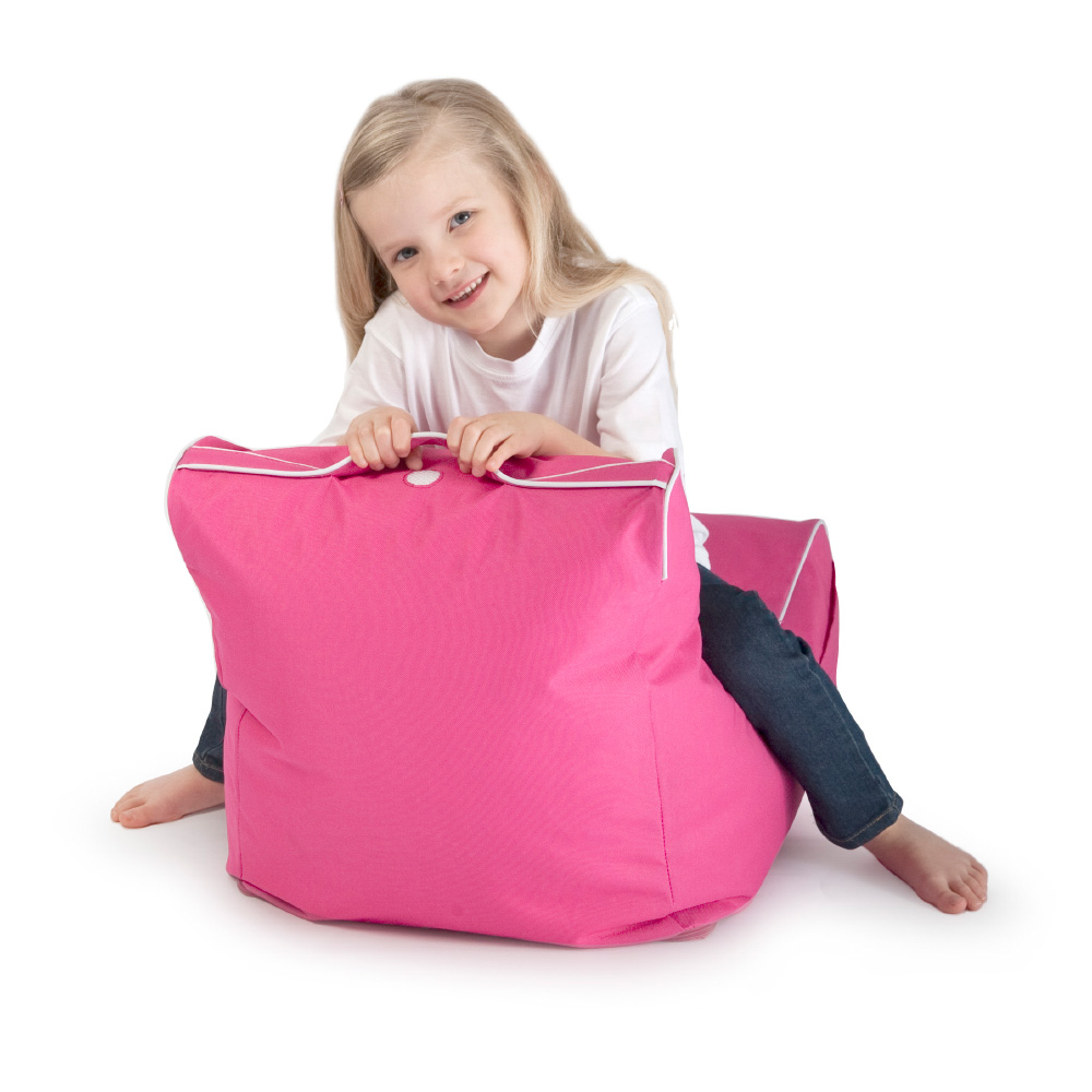 Kid sits on child size pink coastal lounge bean bag holding onto the handle