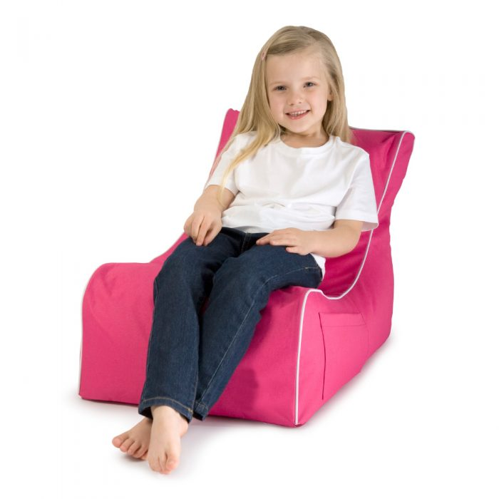 Child reclines on the kids size pink coastal lounge bean bag