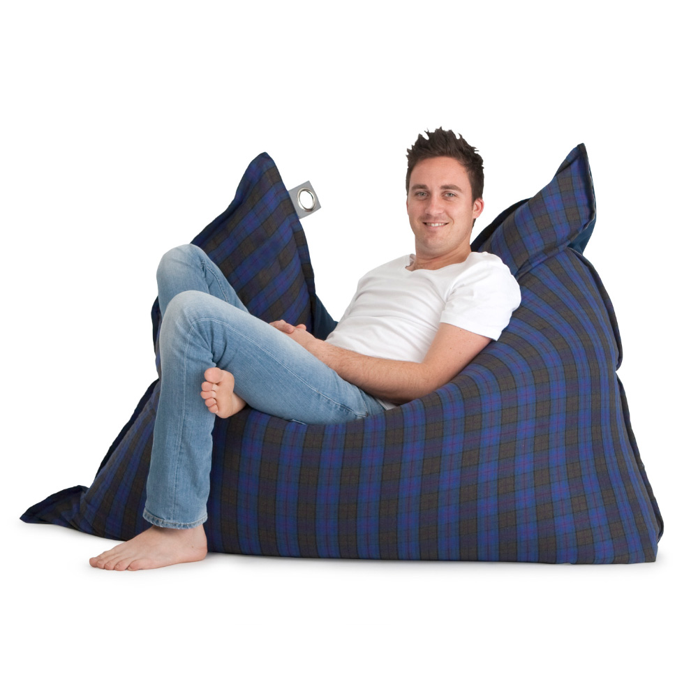 Man reclines in a large supersized arcadia dream bean bag in blue and grey check