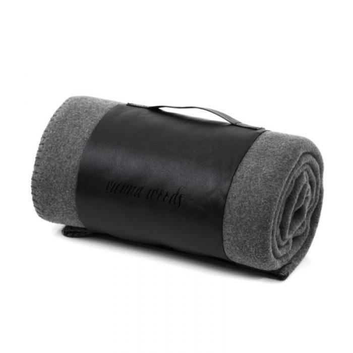 Rolled grey designer fleece rug showing carry handle