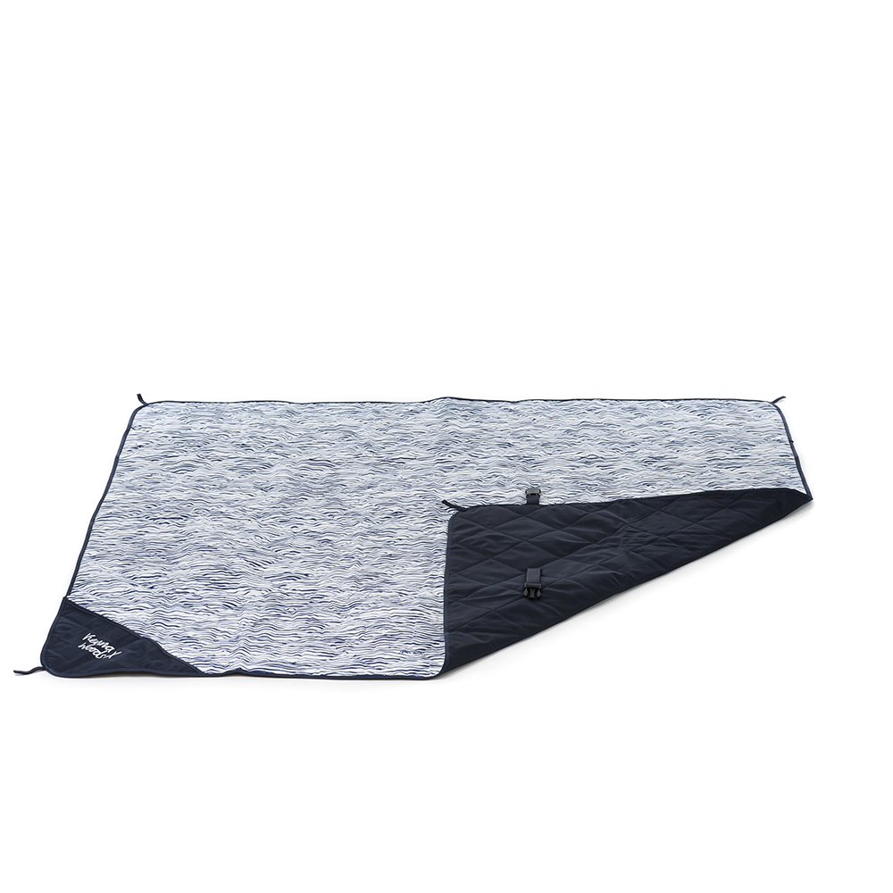 The marine print adventure mat, picnic blanket, beach rug with the corner rolled over to show the contrast underside and closing clasp