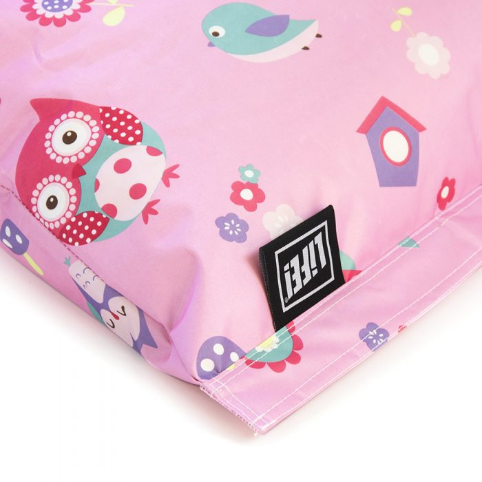 Close up of the life logo tag on the pink owl print sunny boy shaped kids bean bag