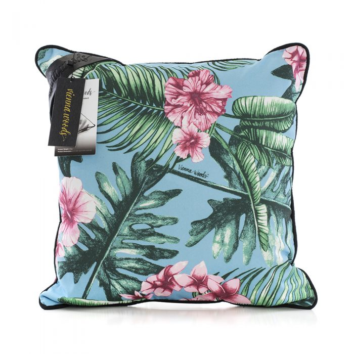 The belvedere indoor outdoor cushion on a white background. The handrawn print features pink tropical flowers on a blue background with green leaves and cushion is trimmed with black.