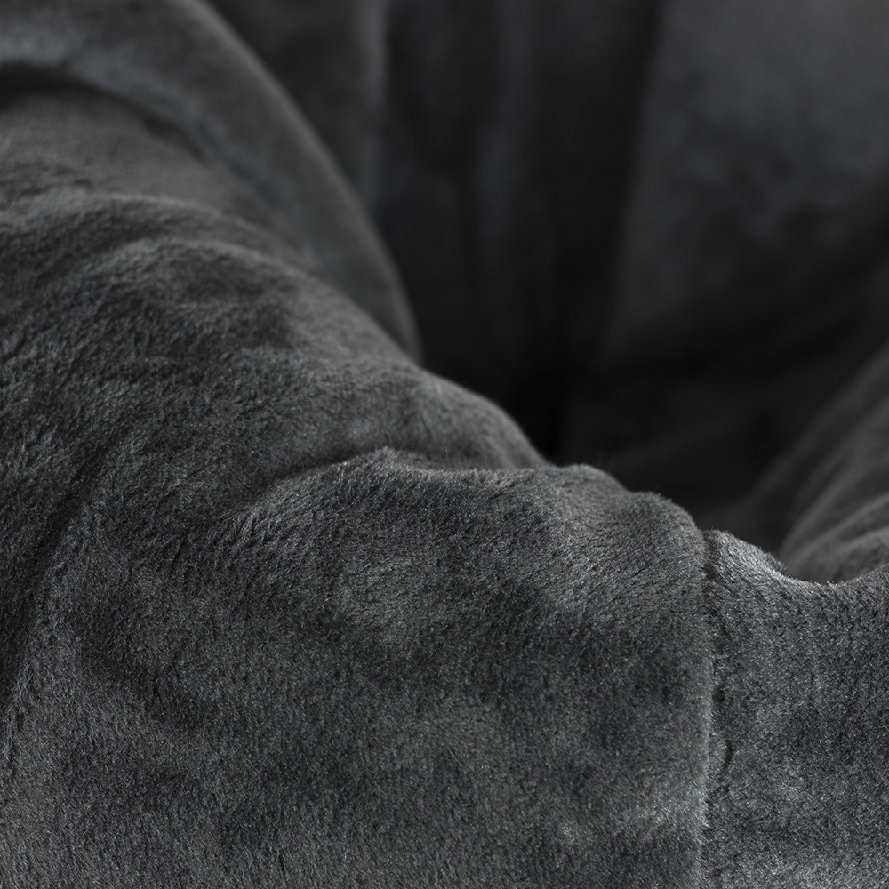 Close up of fabric detail on the super size slate grey faux fur tear drop shaped bean bag