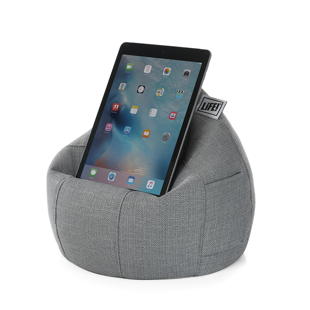 A tablet sits on a grey linen look iCrib iPad holder stand cushion bean bag. The storage pocket is visible
