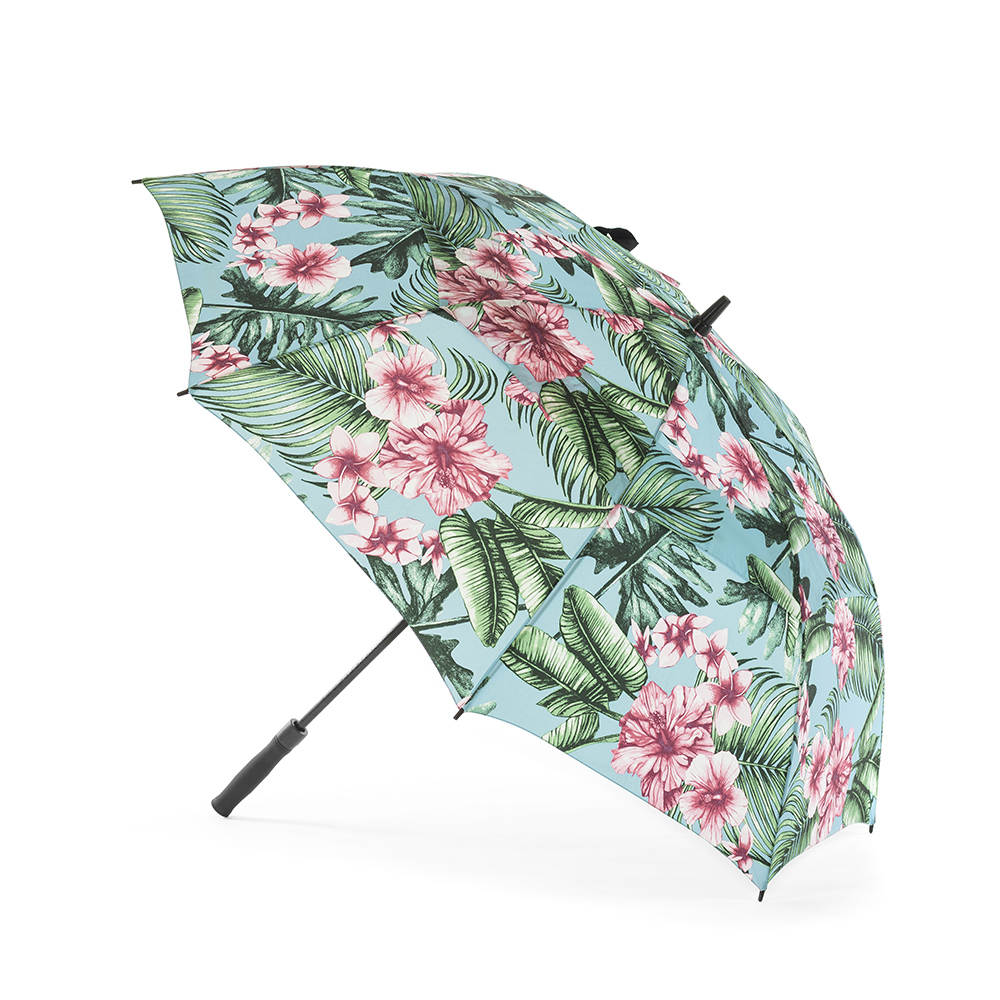 The bermuda print rain umbrella show open from the side. The tropical print has pink hibiscus and frangipani on a blue base color.
