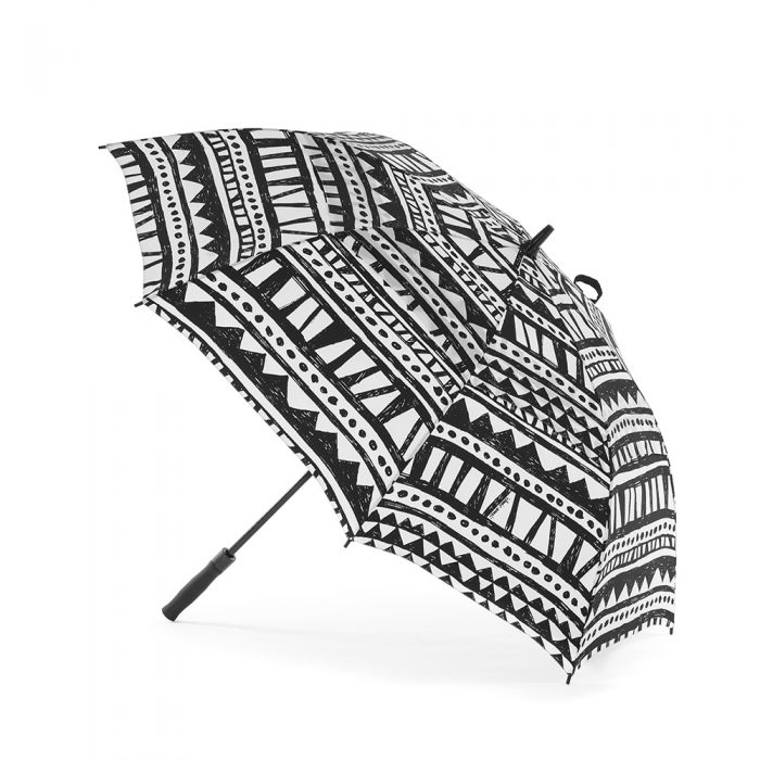 The bermuda rain umbrella shown open from the side. The print is handrawn black and white geometric repeating pattern.