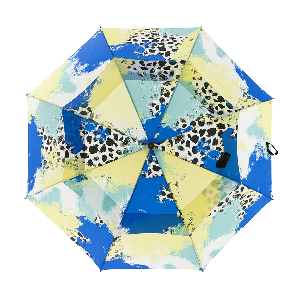 Tier print large golf rain umbrella shown open. The print is green, yellow, white and blue with black splotches. You can see the two layer vent system.