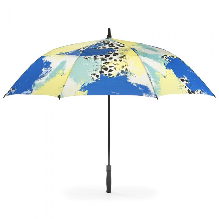 Tier print umbrella shown open from the side. The print is yellow, blue, green and white with black spots.