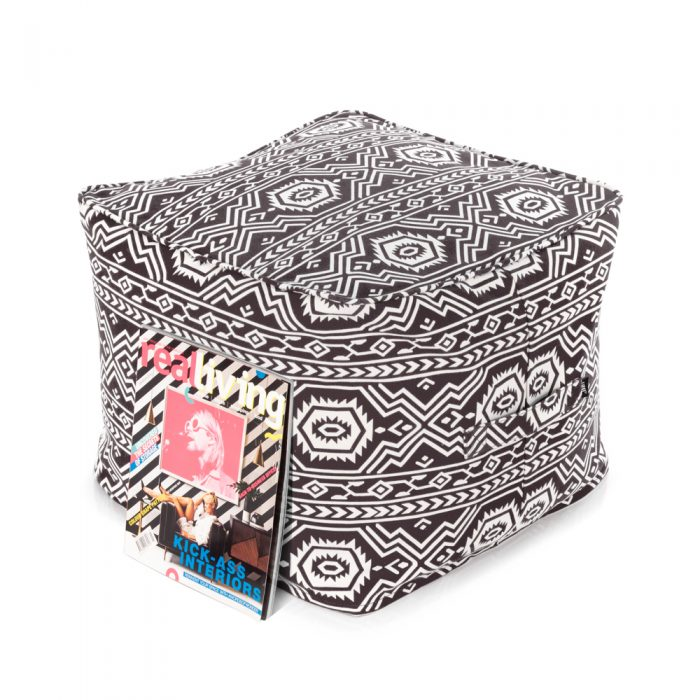 magazine rests against a black ottoman with white aztec geometric tribal print