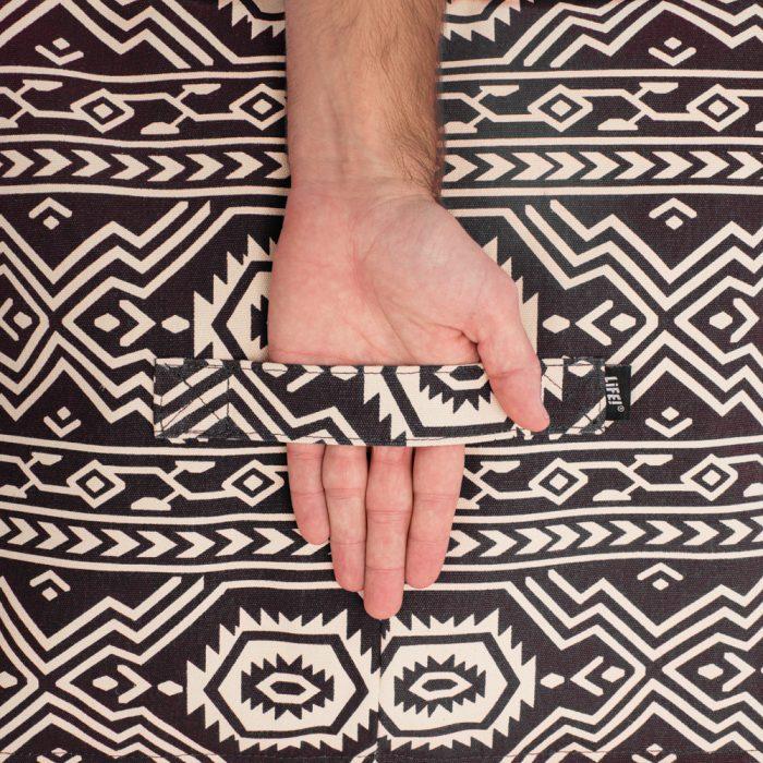 Close up of the handle on the black aztec geometric tribal print ottoman